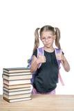 Schoolmeisje met omhoog duimen stock foto's