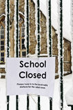 Schools Out. A sign hung on the school gates, informing parents, staff and children their school is closed Stock Image