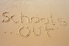 Schools Out in the sand. Schools out written in the sand royalty free stock photo