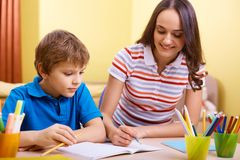 Schoolwork with mother Royalty Free Stock Image