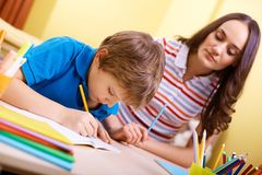 Schoolwork with mother Stock Image