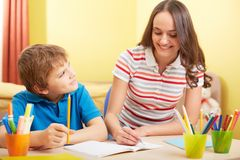 Schoolwork with mother Royalty Free Stock Photo