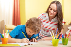 Schoolwork with mother Royalty Free Stock Photography