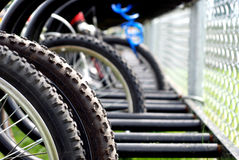 Schoolyard Bike Rack. Elementary school yard bicycle rack with shallow focus Stock Photos