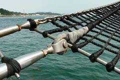 A schooner marine rope ladder. Perspective and detail view of a schooner marine rope ladder royalty free stock photo