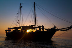 Schooner Pirate Ship in Sunset Stock Images