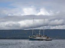 Schooner rigged motor sailer in the bay Stock Photos
