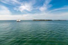 Schooner Sailing Past Island Royalty Free Stock Images