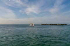 Schooner Sailing Past Small Island Royalty Free Stock Photography