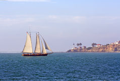 Schooner sails past Point Loma near San Diego, Cal royalty free stock photography