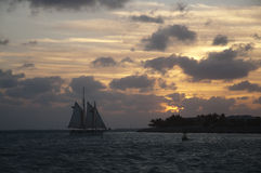 A schooner at sunset on a cloudy day Royalty Free Stock Images