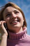 Schoonheid en de telefoon stock foto