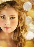 Schoonheid in gouden lichten Stock Afbeelding
