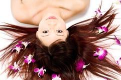 Schoonheid met Orchideeën Stock Foto's