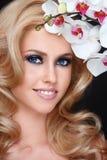 Schoonheid met orchidee royalty-vrije stock foto's