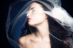 Schoonheid onder sluier Royalty-vrije Stock Afbeeldingen