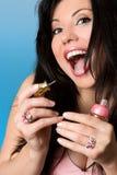 Schoonheid - vrouw met roze nailpolish stock afbeelding