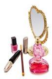Schoonheidsmiddelen en spiegel Stock Afbeeldingen