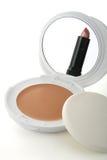 Schoonheidsmiddelen, spiegel en lippenstift Stock Foto
