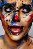 Schoonheidsportret van jonge Vrouw met Clownsamenstelling royalty-vrije stock foto