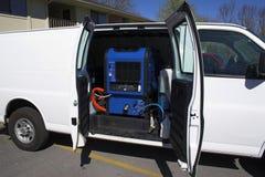 Schoonmakende bestelwagen 2 van het tapijt Stock Foto's