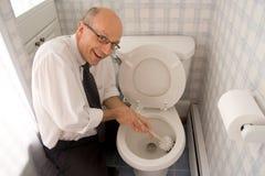 Schoonmakende toilet het bedrijfs van de Mens Royalty-vrije Stock Afbeeldingen