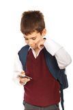 Schooolboy reading sms Royalty Free Stock Photos