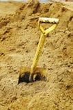 Schoppen in zand Stock Fotografie