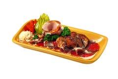 Schotel met vlees stock foto