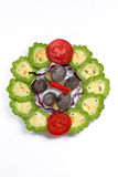 Schotel van slak, bittere citroen, tomaat en Spaanse pepers Royalty-vrije Stock Fotografie
