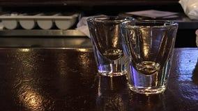 Schoten bij de bar Stock Afbeelding