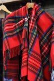 Schotse die herinneringen van rood geruit Schots wollen stof worden gemaakt Royalty-vrije Stock Afbeeldingen