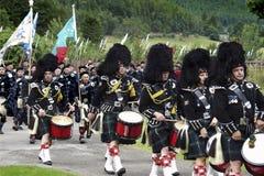 Schotse het Marcheren Band bij de Lonach-Hooglandspelen in Schotland stock fotografie