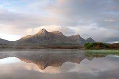 Schotse Nauwe vallei in vroeg licht Stock Foto's