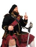 Schotse strijder met fles rode wijn Royalty-vrije Stock Foto's