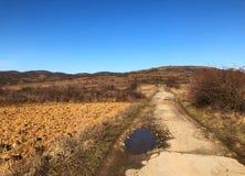 Schotterweg auf Berg Lizenzfreie Stockfotografie
