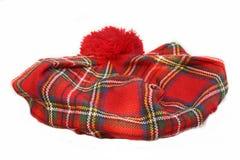 Schottischer Schottenstoffhut mütze lizenzfreie stockbilder