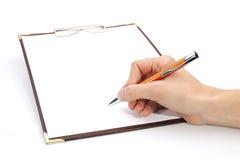 schowka ręki writing Fotografia Stock