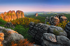 Schrammsteine, beautiful evening view over sandstone cliff into deep misty valley in Saxony Switzerland, evening background, the. Schrammsteine, beautiful stock photo