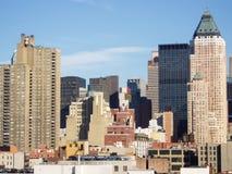 Schrapers van Uit het stadscentrum Manhattan Stock Foto's