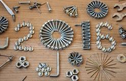 Schraube, Nägel, Bolzen, Nuss, 2016 neues Jahr Lizenzfreie Stockfotografie