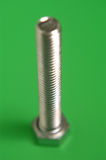 Schraube, Schraube mit einem grünen Hintergrund Stockfotos
