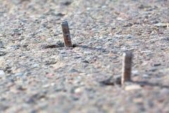 Schrauben im Beton Stockbilder