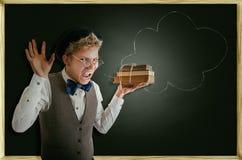 Schrecklich schreiender Student mit Büchern Lizenzfreie Stockfotos