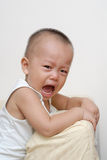 Schreeuwende Aziatische baby Royalty-vrije Stock Foto's
