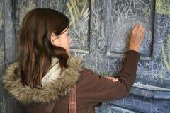 Schreiben auf die Wand Stockbild