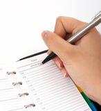 Schreiben auf einen Organisator stockfotografie