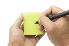 Schreiben auf Notiz Lizenzfreie Stockbilder