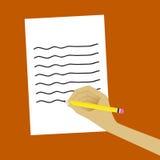 Schreiben in das Papier Stockfotos