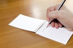 Schreiben einer Anmerkung Lizenzfreies Stockbild